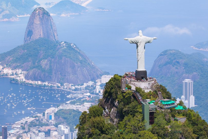 Aerial view of Rio de Janeiro featuring Christ the Redeemer and Corcovado Mountain. (Shutterstock Photo)