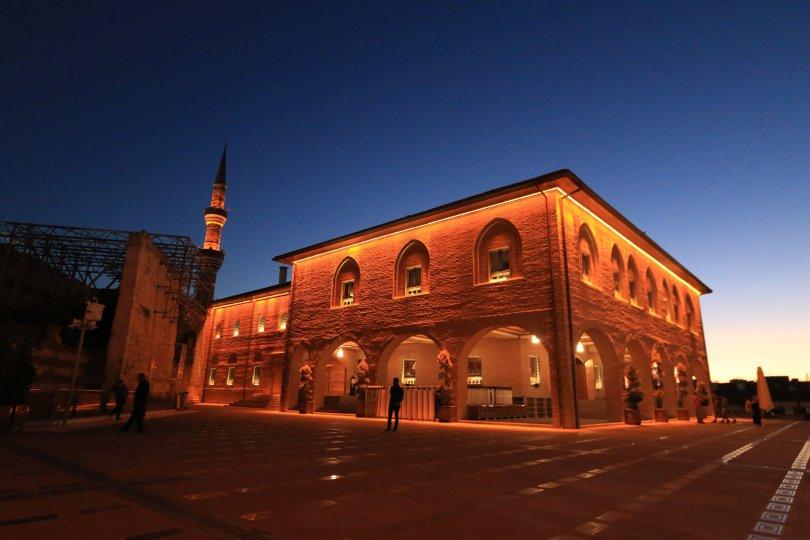 Hacı Bayram Veli Mosque is lit with red lights as night nears in, Ankara, Turkey. (Shutterstock Photo)