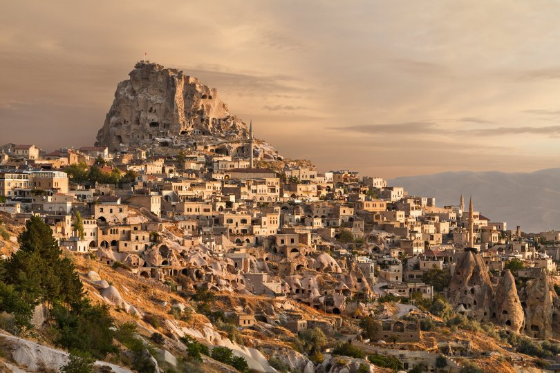 The sun sets upon the Uçhisar town of Cappadocia, in Nevşehir, Turkey. (Shutterstock Photo)
