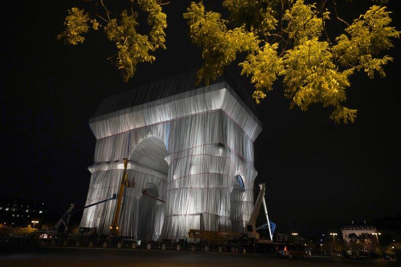 Workers wrap the Arc de Triomphe monument, Paris, France, Sept. 15, 2021. (AP Photo)