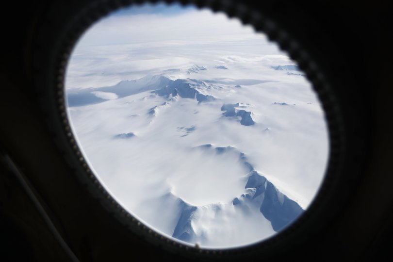 Mountains and land ice are seen from NASA