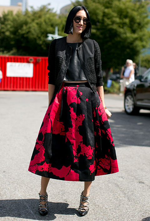 Eva paired a leather Tibi crop-top with a Tibi skirt, Balenciaga heels, and a Chanel bag.