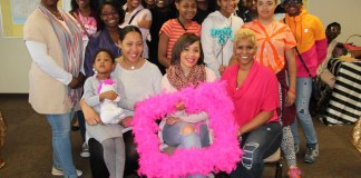 Standing, far left: Robyn Washington, IEA Region 26 UniServ director. Seated, left to right: Tomika Halsey, IEA Region 27 UniServ director (with daughter MaKala); Tiffany Fincher, founder and executive director, Aspirations of Life; LaSonya Burnett, owner, Jes' Us Hair Salon.