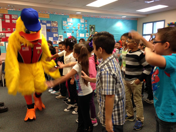 iecn photo/yazmin alvarez Stewie the Duck, with the help of Rialto firefighters, taught Fitzgerald Elementary first graders the importance of water safety.