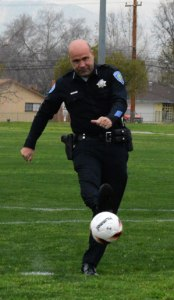 Photo/Richard Dawson Police Chief Burguan, the San Bernardino interim City Manager, kicks a ceremonial goal on some of the newly renovated soccer fields.