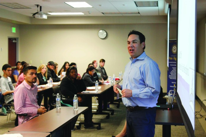 Photo/Anthony Victoria: Congressman Pete Aguilar (D-San Bernardino) speaking to students and residents about the importance of receiving financial assistance for college during a Financial Aid workshop at the Roy C. Hill Education Center in San Bernardino on Feb. 27.