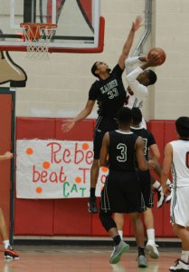 Photo/Richard Dawson Armani Dodson (#33) contests a shot. He finished with 19 points and 10 rebounds for Kaiser.