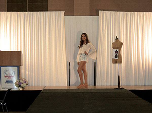 iecn photo/yazmin alvarez A student model walks the runway during last year's Angels'Closet Charities fashion show at Redlands East Valley High School. The organization provides clothing and accessories to students in need.