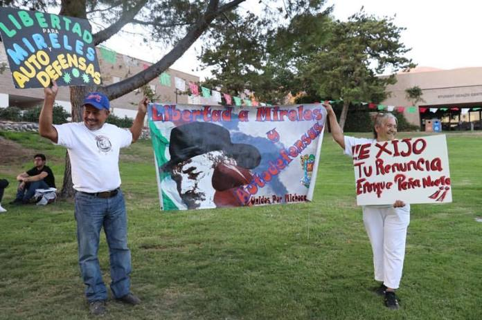 "Photo/Anthony Victoria: Francisco Zepeda and Genesis Godine want to make sure Mexicans and Mexican Americans alike know about the injustices taking place back home. ""What happened to Land and Liberty, the promise that our hero Emiliano Zapata fought and died for?"""