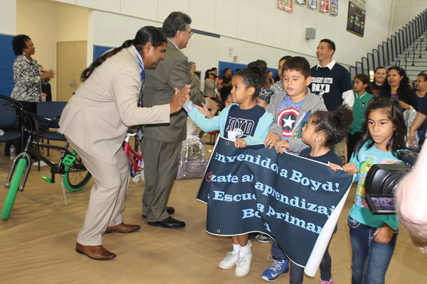 courtesy photo/ rialto unified school district RUSD Board member Edgar Montes high fives and cheers students on during the opening rally at the 8th annual Parent Summit at Carter High School Oct. 15.