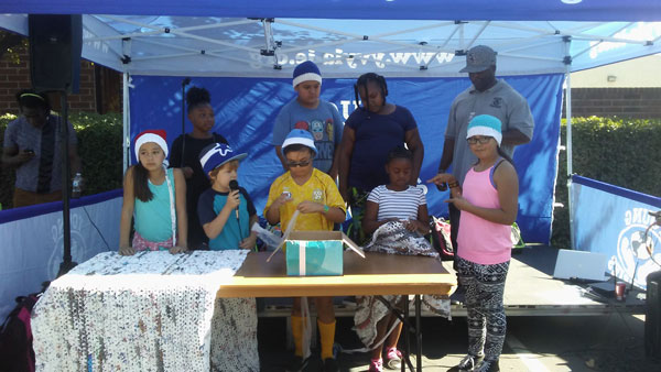 Photo/MJ Duncan Nearly a dozen 4th graders from Parkside Elementary demonstrated how they turned plastic bags into mats for the homeless during the annual Community Wellness & Resource Fair on Saturday at the New Hope Family Life Center in San Bernardino.  Pictured from left:  Katie Ramirez, Karmah Harris, Bob Cline, Noah DeLaTorres, Jose Regalado, Chloe Becker, Halani Burden-Webb, Young Visionaries Youth Leadership Academy President/CEO Terrance Stone, and Ashley Ramirez.