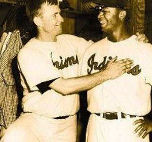 AP File Photo Bob Lemon (Left) greets new Cleveland Indian's teammate Larry Doby in 1948. Doby had just been signed after playing for Kansas City Monarchs of the Negro League.