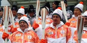 Bob Steadward (l) and Andrew Parsons (r) at the 2018 torch relay. (Photo by David Legg)