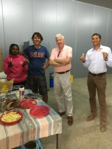 New Holland Chips factory in Laikipia. From left to right: Judith Chabari, 2SCALE cluster advisor, Kenya; New Holland Chips owner, Jean Pierre; Scott Angle; and Alexander Fernando, IFDC deputy director for East and Southern Africa.