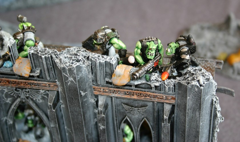 Ork Shooty Boyz defend some ruins in an Imperial City during a Warhammer 40000 Cities of Death game.