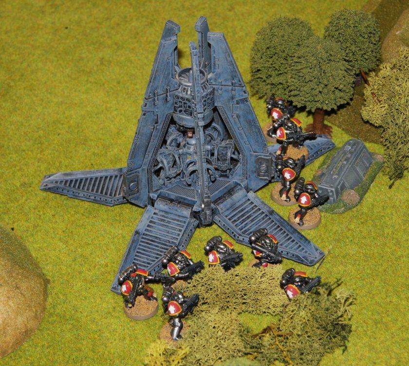 Simon's Drop Pod drops off its load of Space Marines.