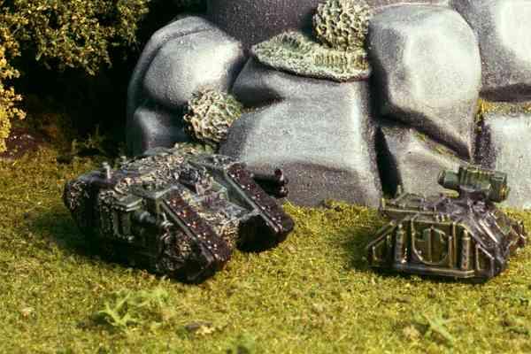 Land Raider (with camo netting) and Rhino AT.