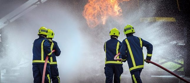 Firefighters tackle a blaze during a training exercise at their specialist training ground at BAE Systems' Warton site in Lancashire.