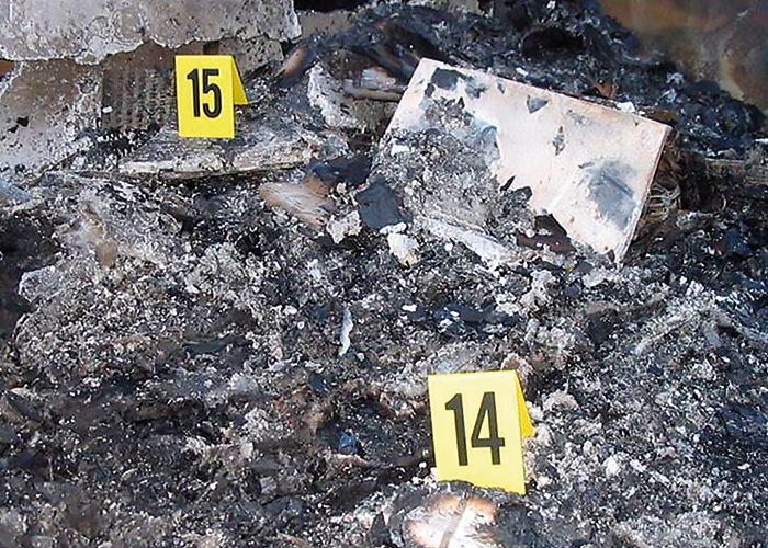Evidence markers in a fire scene.