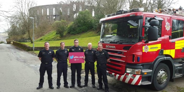 Scottish Fire and Rescue Service crew (Group 1) from Oban in front of the town's famous McCaig's Tower