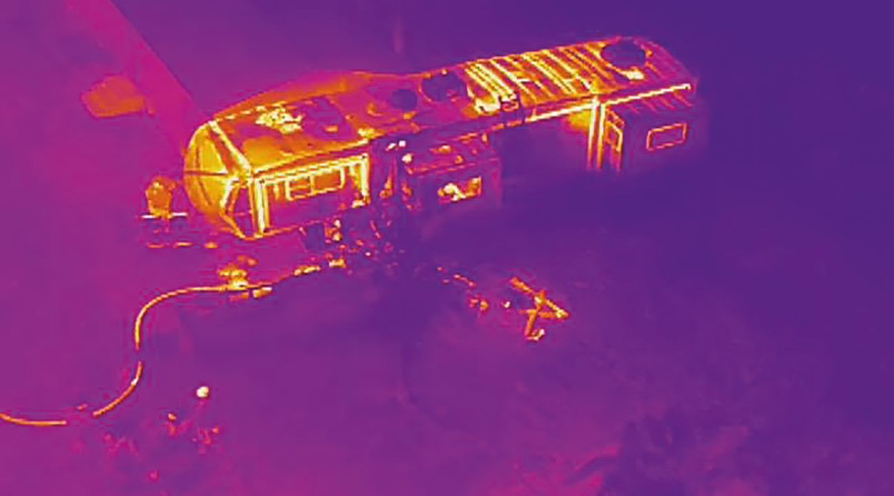 Using thermal imaging, firefighters can see exactly where the fire is located in this RV fire.