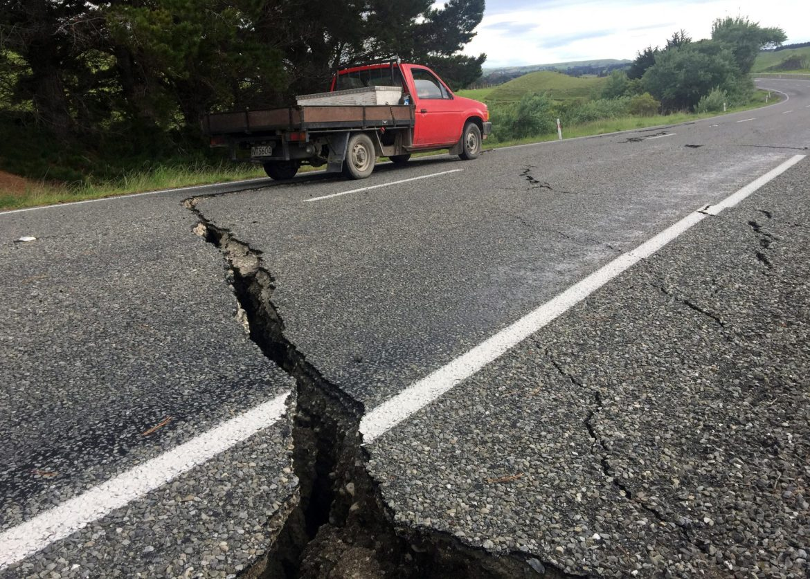 A truck drives over the fractured road caused by an earthquake south of the New Zealand town of Ward on the South Island, November 14, 2016. REUTERS/Anthony Phelps