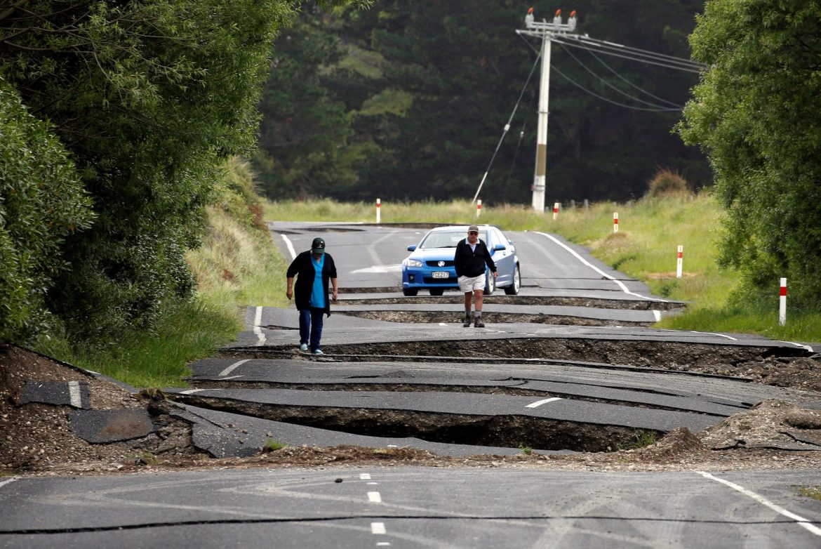 Local residents Chris and Viv Young look at damage caused by an earthquake along State Highway One, south of the township of Blenheim on New Zealand's South Island, November 14, 2016. REUTERS/Anthony Phelps