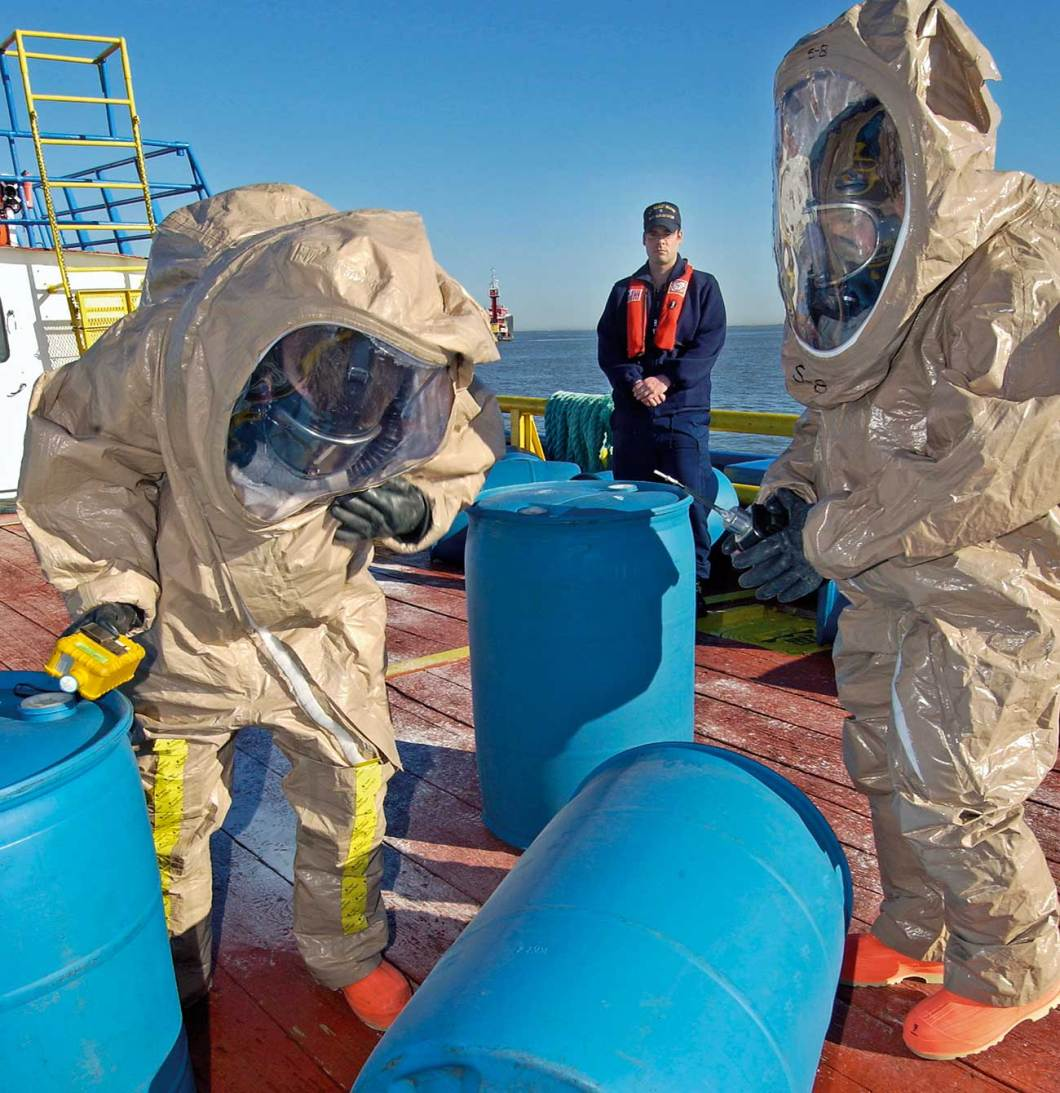 Haz Mat trained Coast Guard personnel take air samples during a Haz Mat drill.