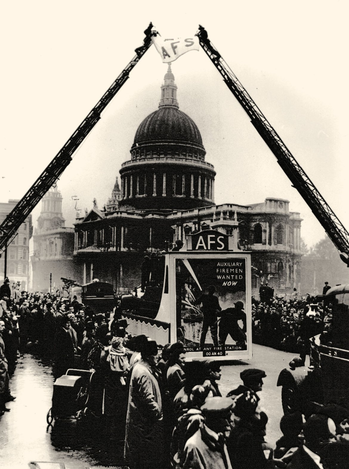 This view of a major recruitment drive outside St Paul's Cathedral in early 1941 was with a nationalised fire service in mind.