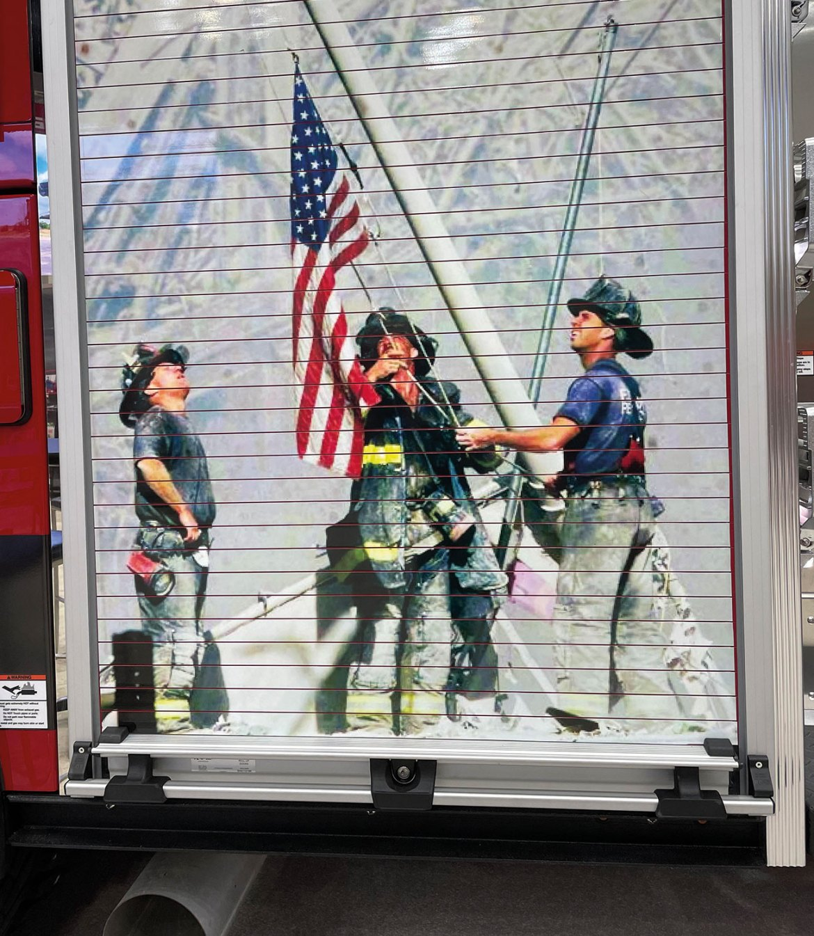 This 9/11 Memorial mural was spotted on the back of a fire apparatus at FDIC2021 in Indianapolis, Indiana. September 11, 2021 will be the 20th anniversary of the 9/11 terrorist attack.