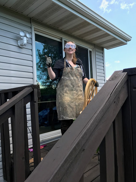 Wearing protective clothing while refinishing a wood kitchen table