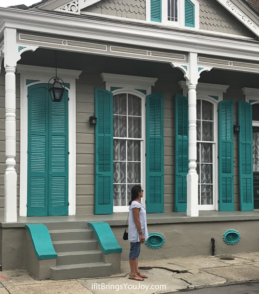 Spectacular New Orleans architectural elements! Bright turquoise shutters on New Orleans shotgun house.