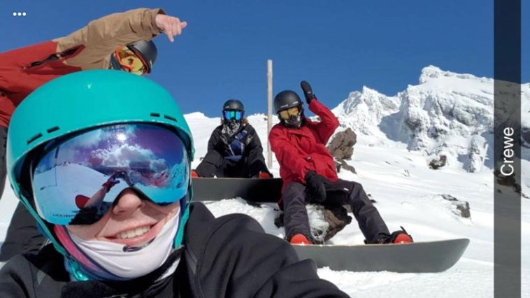 Snowboarding friends taking a break on Mt. Ruapehu in New Zealand.