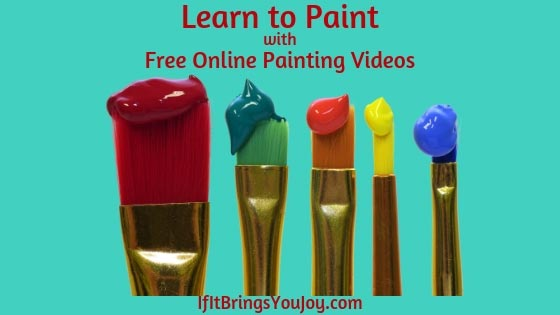 Paint brushes with bright acrylic paints