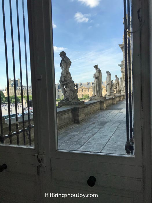 View looking outside from the inside of the Louvre Museum in France