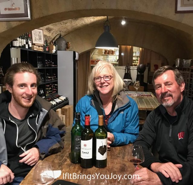 Family in winery after wine tour in Blaye, France