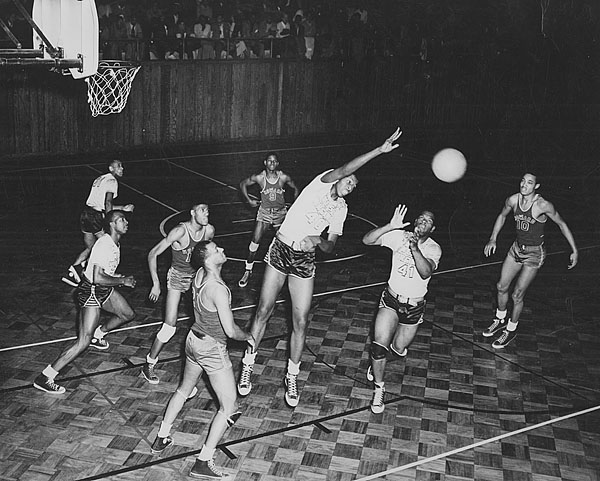 Earl Lloyd, the first black player in the NBA, lived in Institute and played for the West Virginia State College Yellow Jackets from 1946-50. Earl Lloyd is at center in this photograph from 1949, courtesy of West Virginia State University Archives.
