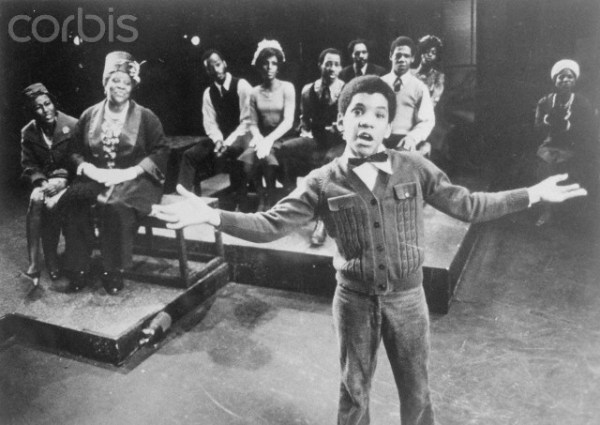 Ralph Carter, (foreground), and Virginia Capers along with Ernestine Jackson, (R), his proud grandmother and mother, are shown watching him in this church scene in the new musical Raisin which premiered on October 18, 1973, at the 46th Street Theater. Donald McKayle was the director-choreographer. Robert Nemiroff was the producer.