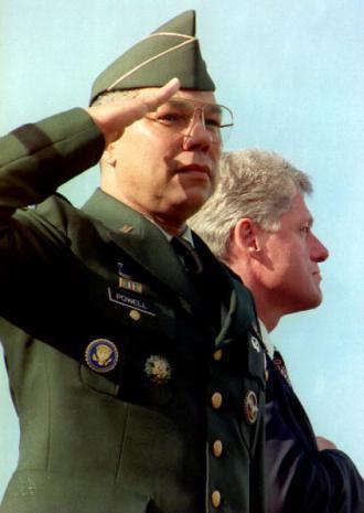 U.S. Gen. Colin Powell salutes as U.S. President B
