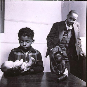 """Gordon Parks, photographer. Dr. Kenneth Clark conducting the """"Doll Test"""" with a young male child, 1947. Gelatin silver print. Prints and Photographs Division, Library of Congress"""