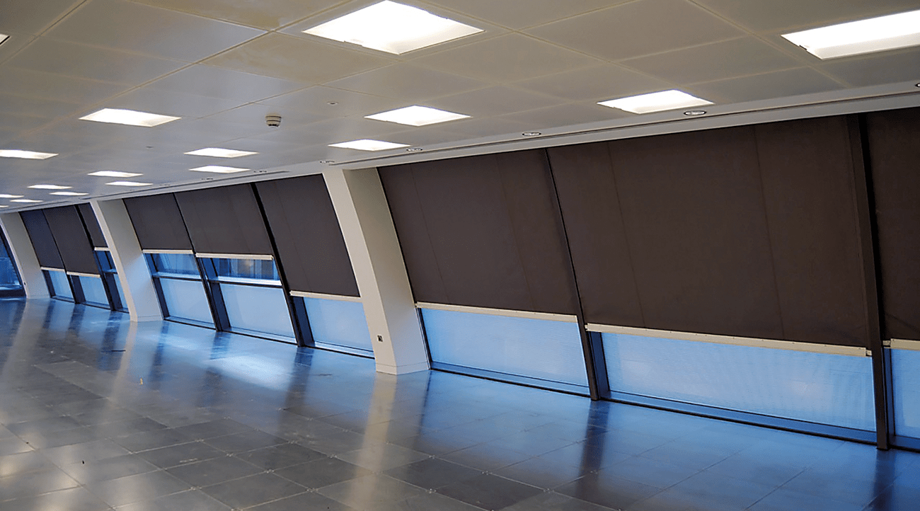 Boundary protection fire curtains over windows at Dover Street, London.
