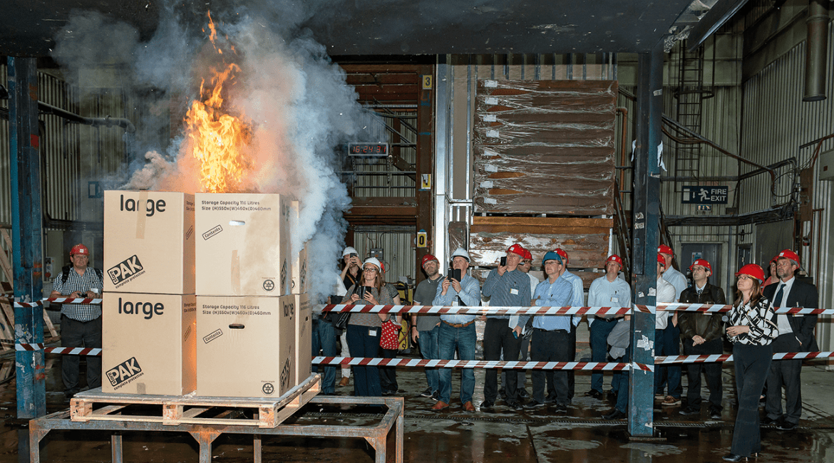 A group of delegates view a live fire demonstration in BRE's Burn Hall, one of Europe's largest facilities for assessing systems fire performance and fire suppression.
