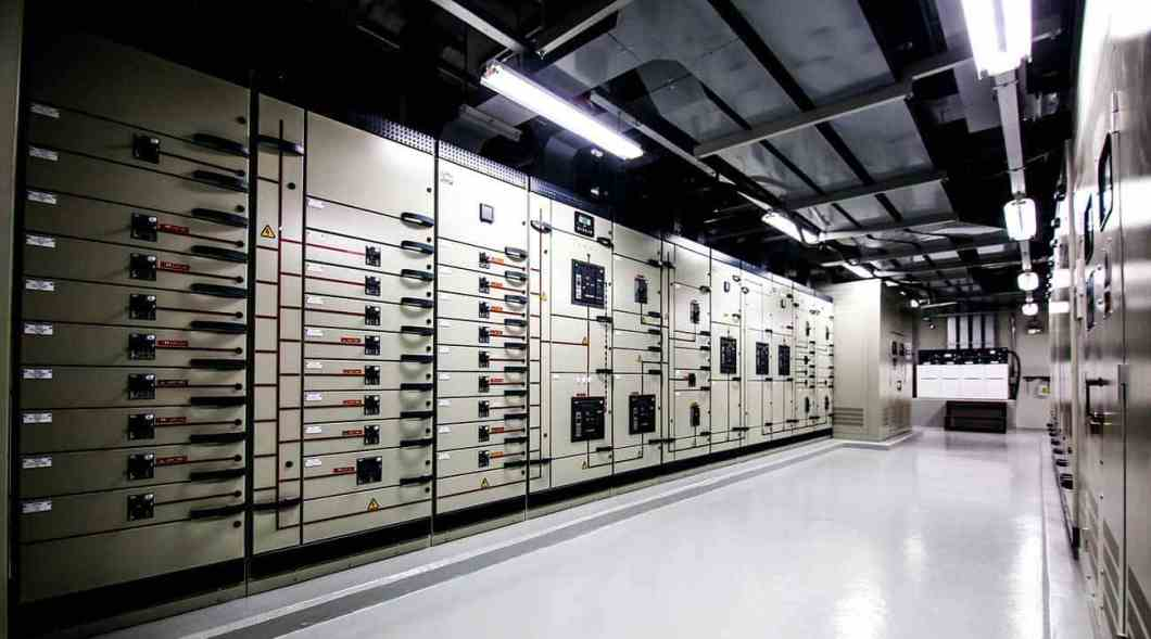 Global data center walkway between rack cabinets modern industrial IT world communications and internet.