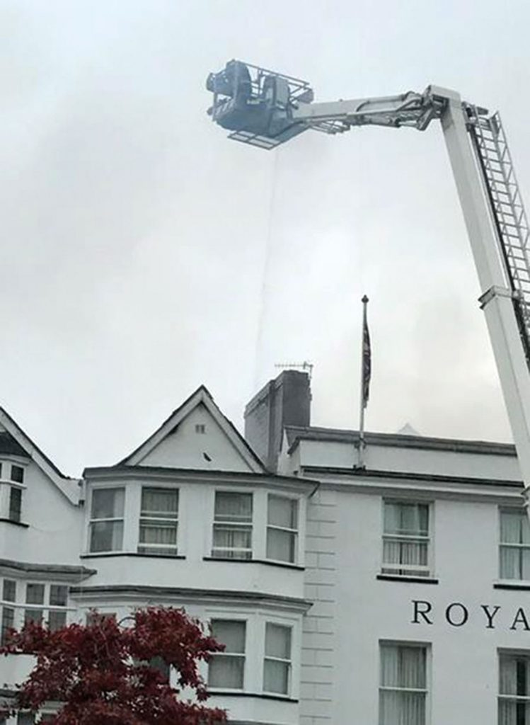 0957hrs  The ALP is in use and water is being hosed into the Royal Clarence Hotel.