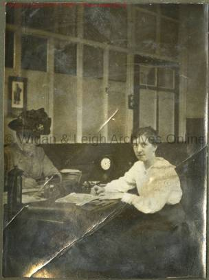Two secretaries in the offices at Howe Bridge Mills, c.1918 The contrast between the work that the young woman in this photo would have been doing with her contemporaries working elsewhere in the mill is unimaginable. (Source: Wigan Archives & Leigh Local Studies - copyright)