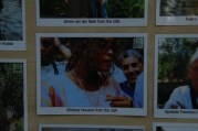 On a board with photos of people who were baptised at Yardenit