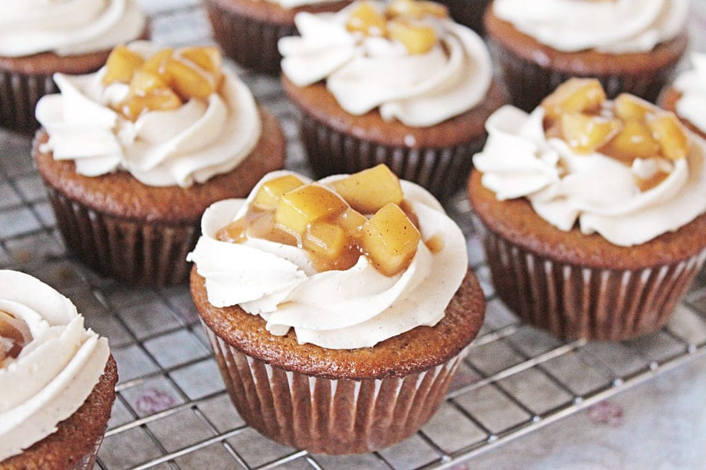 spiced fireball cupcakes with frosting and sauteed apples on top