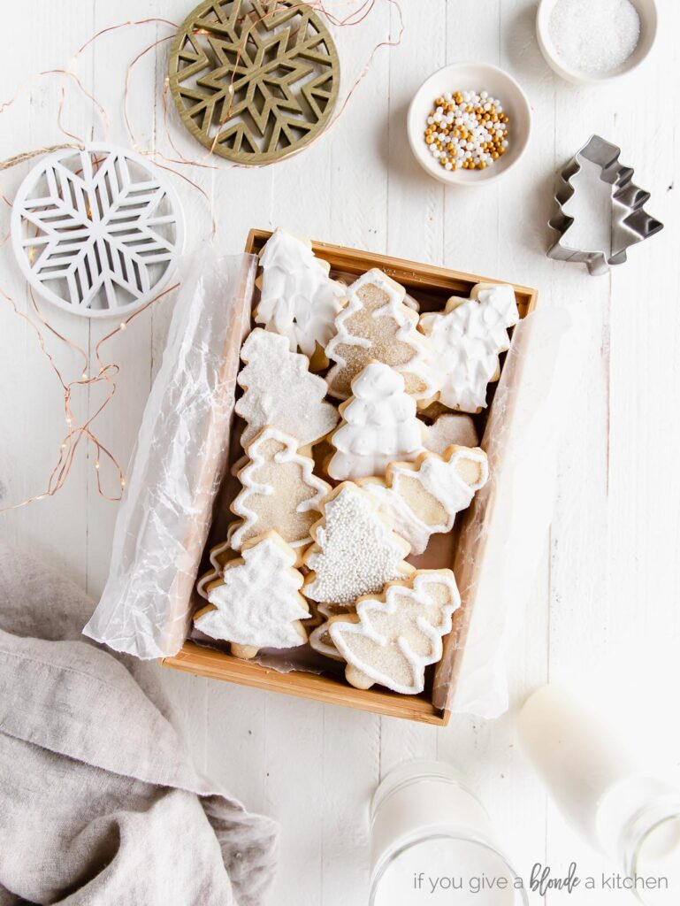 iced christmas tree cut out sugar cookies in a wood box