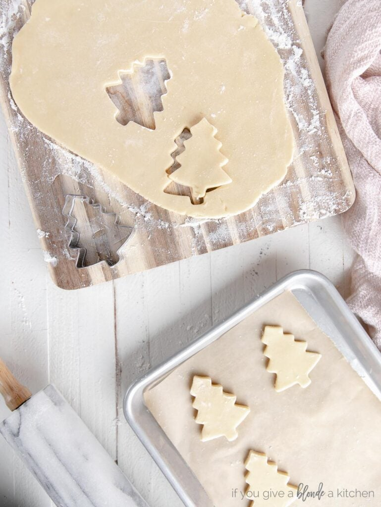 no chill cut out sugar cookie dough rolled out with christmas tree cut outs of dough