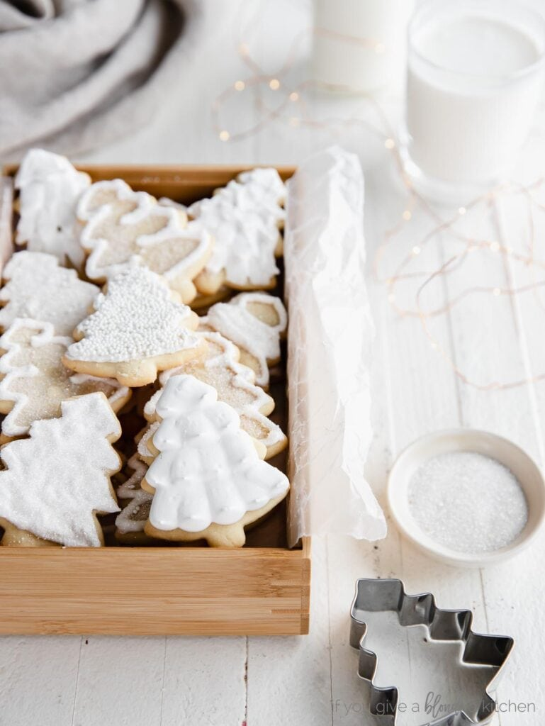 iced cut out sugar cookies in a box